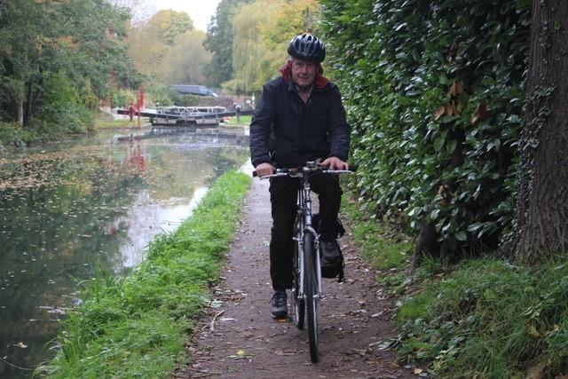Lucas Schoemaker Stroud Trinity Town councillor, using the canal cycle path.