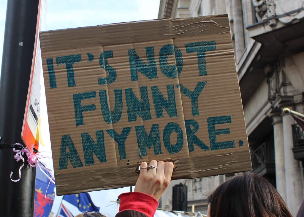 Placard saying It's not funny any more
