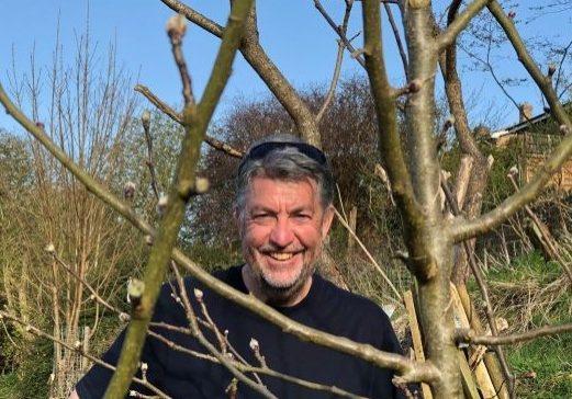Smiling man among trees